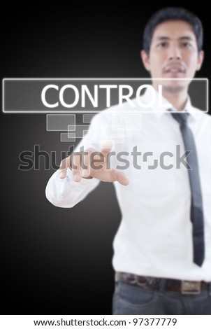 Businessman pushing Control word on a touch screen interface.