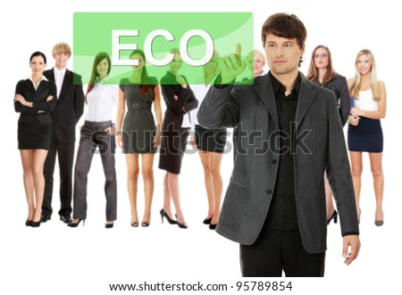 Businessman pushing ECO on a touch screen interface. Business team at background
