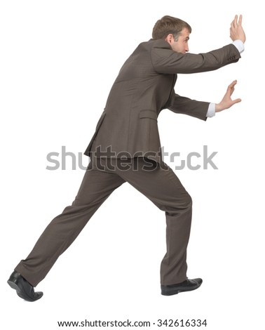 Businessman pushing empty space on isolated white background