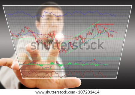 Businessman pushing finance graph for trade stock market on tablet screen. - stock photo