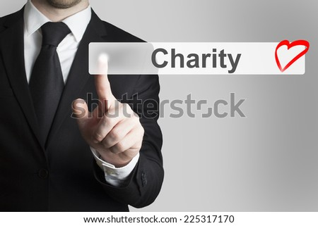businessman pushing flat button charity red heart symbol - stock photo
