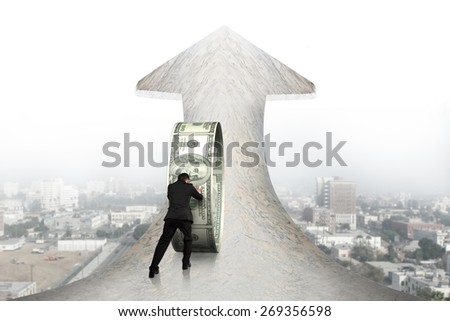 Businessman pushing money circle on arrow up sign marble road with cityscape background - stock photo