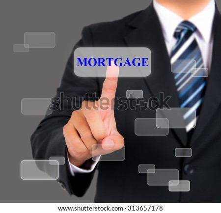 Businessman pushing mortgage on a touch screen interface