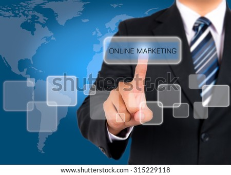 Businessman pushing on a touch screen interface on online marketing button