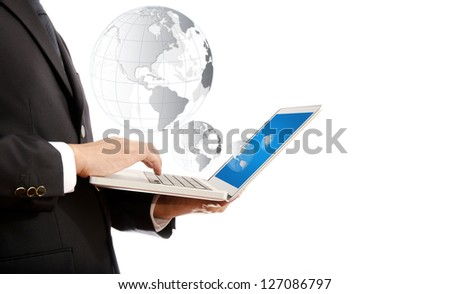 Businessman pushing on laptop keyboard for Business Concept with World Map Globe.