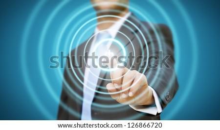 Businessman pushing power button - stock photo