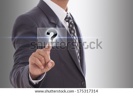 Businessman pushing Question mark on a touch screen interface  - stock photo