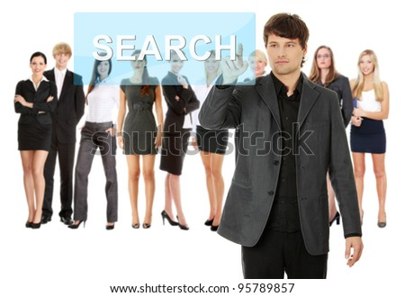 Businessman pushing SEARCH on a touch screen interface. Business team at background
