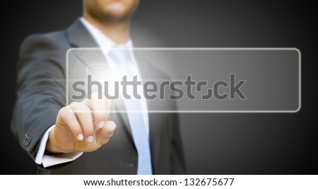 Businessman pushing tactile button