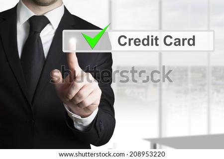 businessman pushing touchscreen button credit card - stock photo