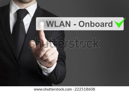 businessman pushing touchscreen wlan onboard - stock photo