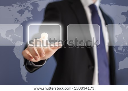 Businessman pushing virtual button on a modern device using touch screen technology with a world map background