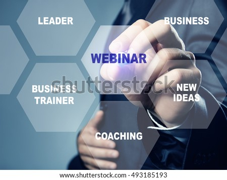 Businessman pushing WEBINAR button on virtual screen. Business coaching and modern technology concept.