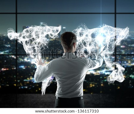 businessman pushing world map on  interface - stock photo