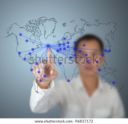 businessman pushing world network connection center button on computer touchscreen