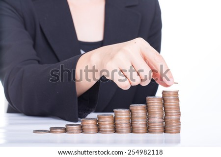 Businessman put coin stack money for money growth concept - stock photo