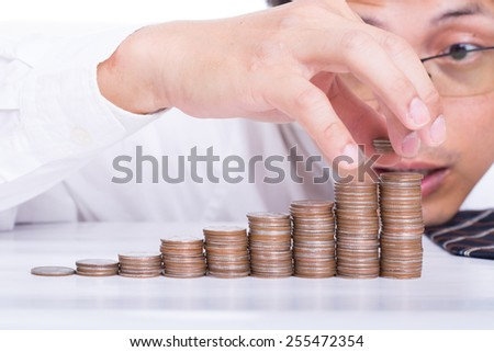 Businessman put coin stack money for money growth concept