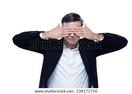 Businessman put his hands over eyes isolated on a white background
