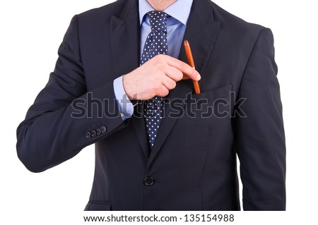 Businessman putting a pen in his pocket. - stock photo