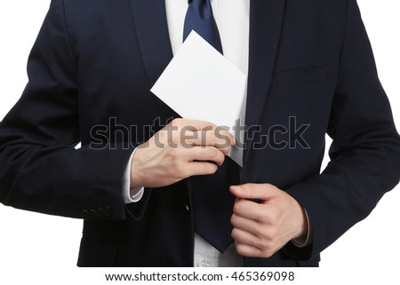 Businessman putting bribe in suit pocket. Corruption concept