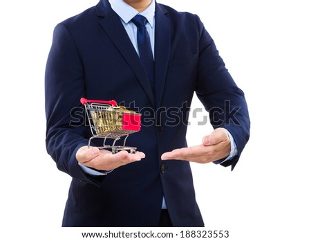 Businessman putting coin into trolley