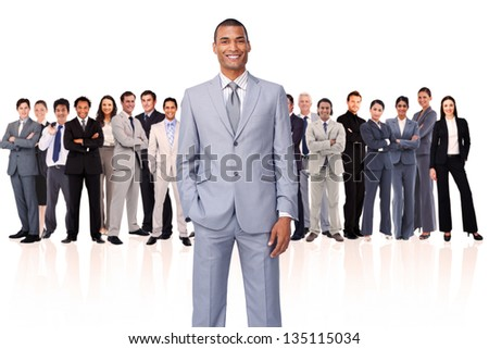 Businessman putting his hand in his pocket against a white background - stock photo