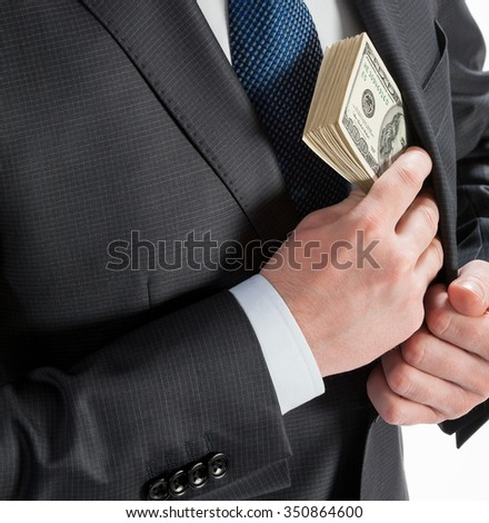Businessman putting money in his pocket - closeup shot
