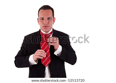 Businessman putting on tie - stock photo