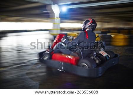 Businessman racing in go-kart - stock photo