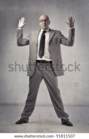 Businessman raising both hands - stock photo