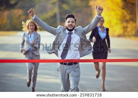 Businessman reaching finish line
