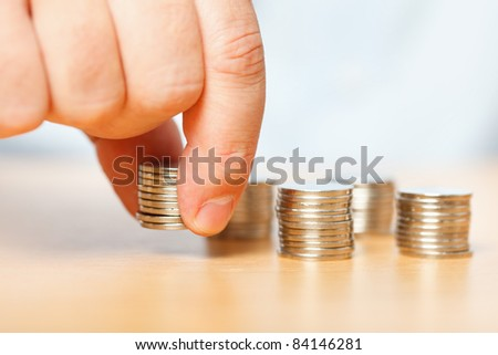 Businessman reaching for pennies, financial crisis concept - stock photo