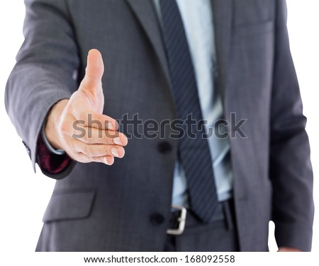 Businessman reaching hand out on white background