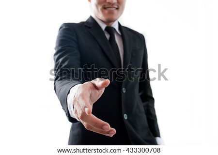 Businessman reaching out to shake hands. isolated on white background  - stock photo