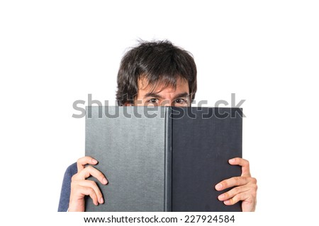 Businessman reading a book over white background