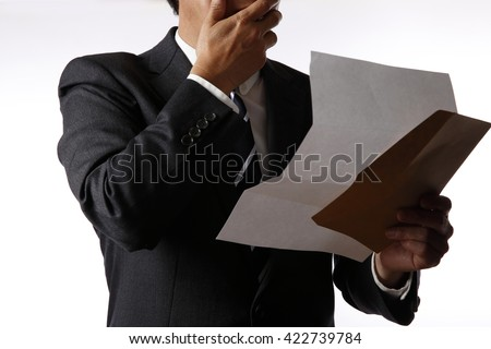 Businessman reading a letter - stock photo