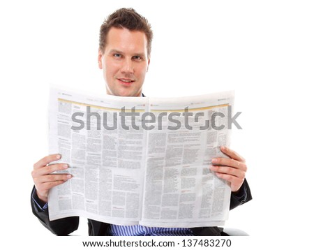 Businessman reading a newspaper isolated on white background - stock photo