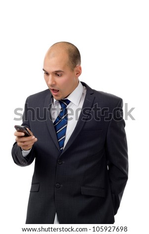 Businessman reading a text message on his smartphone - stock photo
