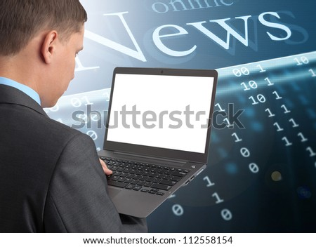Businessman reading news at laptop computer - stock photo