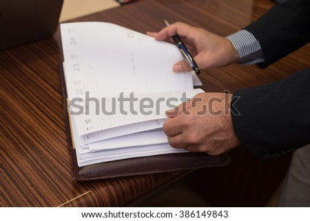 Businessman reads the notes on the agenda