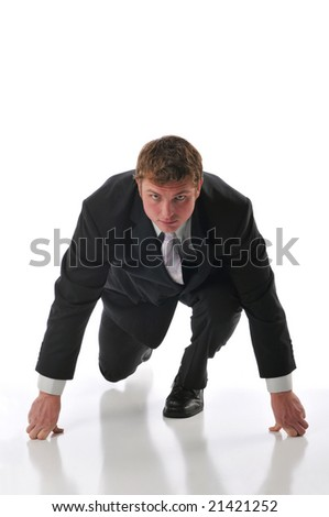 Businessman ready for a race isolated against a white background - stock photo
