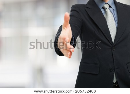 Businessman ready for an handshake - stock photo