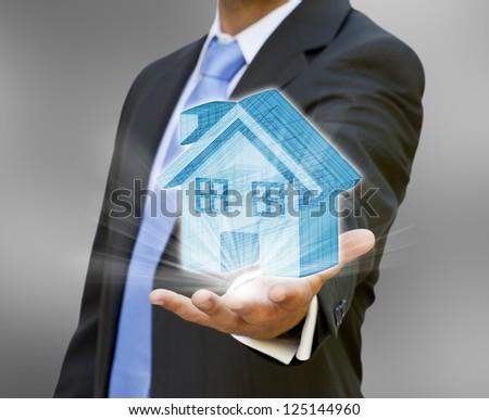Businessman real estate concept - stock photo