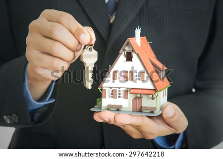 Businessman real estate show model house and real agency property. - stock photo