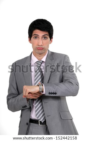 Businessman realizing he is late - stock photo