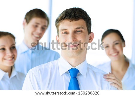 businessman receiving congratulations from his colleagues, business achievements