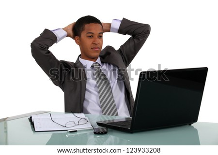 Businessman reclining back in his chair - stock photo