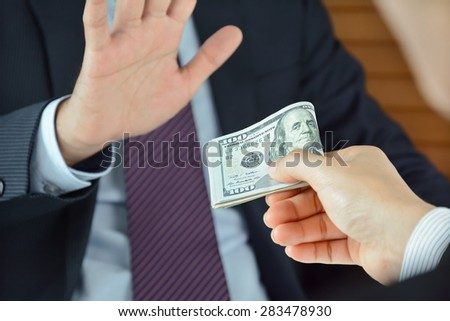 Businessman refusing money, uncorrupted concept - soft focused