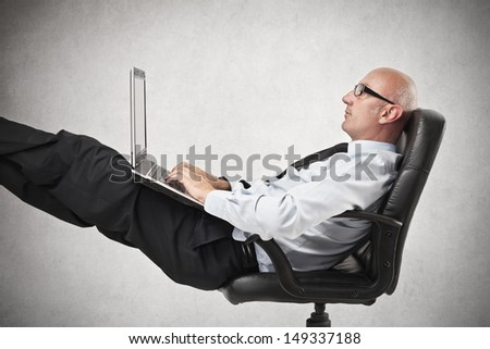 businessman relaxes at the office - stock photo