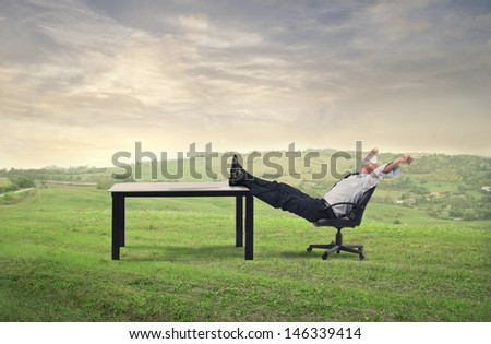 businessman relaxes sitting in the countryside